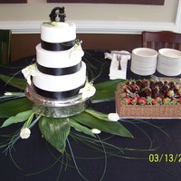 Glass Wedding Almond cake Buttercream icing ribbon borders and live flowers with rhinestones