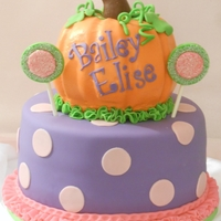 Pumpkins & Polka Dots Done to match the baby's outfit. Bottom cake covered in MMF, top cake covered in BC because she was using it for the smash cake....
