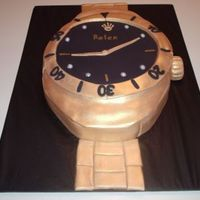 "Gold Rolex Watch A 9"" round with fondant to resemble a rolex."