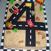 Cars 4Th Birthday 4th Birthday cake. The road is made out of sugar sheets and the decorations are all MMF except for the cars which are toys. The sand is...
