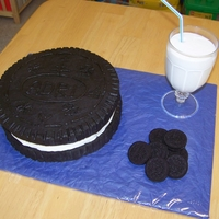 "Oreo Cookie Giant Oreo Made with 3 10"" rounds (before I knew about the cookie cake pan) and the ""glass of milk"" is the trimmed cake with..."