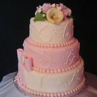 Pearl.jpg   I just did this cake dummy. The flowers I learned from Edna's teaching lessons. Gumpaste flowers and fondant.