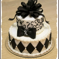 Black And White Wedding Shower Cake   2 tier round cake with black fondant decorations. The grooms mother found a photo online for inspiration.