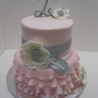 Ruffle Birthday Cake pink, white and silver 2 tier ruffle cake with silver dragees, flower and ribbon