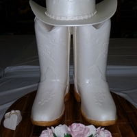 This Is My Entry Into The 2014 Nc State Fair The Boots And Hat Are Styrofoam Covered In Fondant And Airbrushed With Pearl Dustthe Brim Is This is my entry into the 2014 NC State Fair. The boots and hat are Styrofoam covered in fondant and airbrushed with pearl dust.The brim is...