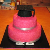 Hot Pink Grad  This cake was inspired by Breezy Blossoms ( Thanks, Paula) It's vanilla cake with strawberry filling, iced in b/c, covered in fondant...