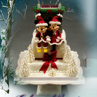 Christmas Cake Mickey And Minnie Christmas cake . Figures hand made in sugarpaste.