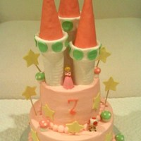 "Princess Peaches Castle Princess Peaches Castle from Super Mario. 9/6"" covered in buttercream with fondant mushrooms and fondant covered turrets. Figures are..."