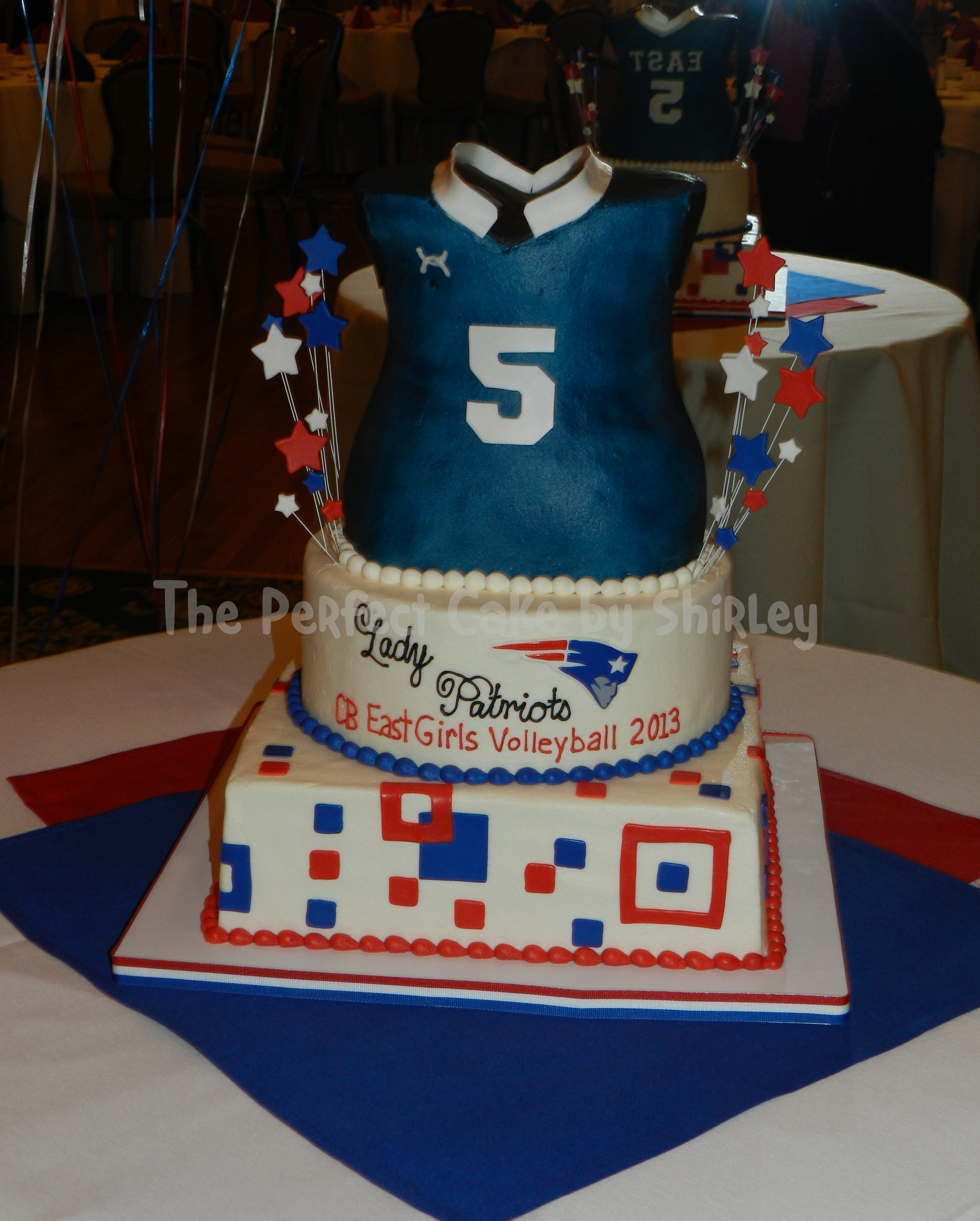 Cb East Girls Volleyball Banquet Cake 3 D Jersey On Top Of Tiered Cake All Cake Iced In Buttercream Jersey Is Airbrushed   CB East Girls Volleyball banquet cake. 3-D jersey on top of tiered cake. All cake, iced in buttercream. Jersey is airbrushed.