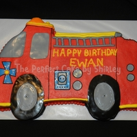 Fire Truck Cutout Cake Fire truck cut out of a 12x18 sheet cake. Iced in buttercream, fondant decorations.