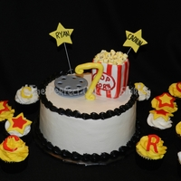 Movie Themed Cake And Cupcakes The Movie Reel Was Fondant And The Popcorn Bag Was Rkt Covered In Fondant I Made The Popcorn From Mini Mar  Movie themed cake and cupcakes. The movie reel was fondant, and the popcorn bag was RKT covered in fondant. I made the popcorn from mini-...