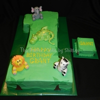 Jungle 1St Birthday Cake Carved From Two Layer 12X18 Sheet Cake Iced In Buttercream Fondant Trees And Landscape And Fondant Animals I M  Jungle 1st birthday cake. Carved from two layer 12x18 sheet cake, iced in buttercream, fondant trees and landscape, and fondant animals. I...