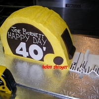Tape Measure  Made this for a handyman....it's his tape measure in front there. Used 5 layers of thick chocolate cake, iced in buttercream, white...