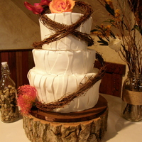 Kelli Jo's Wedding Vanilla cake with vanilla bc. Covered in fondant with fondant overlays.