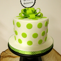 Mekenzie's Cake   Fondant covered key lime cake with key lime bc and raspberry filling. Gumpaste loopy bow.