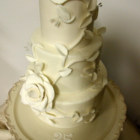 35Th Wedding Anniversary 35th wedding anniversary. Gumpaste rose and leaves. Fondant vine. Inspiration from another cake.
