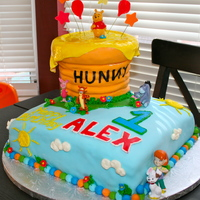 Winnie The Pooh  My son's first birthday cake! vanilla cake with chocolate chip vanilla frosting covered in MMF. The honey pot is also cake. i put...