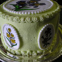 My Mother's 93Rd Birthday Celebration Fudge and yellow cake with fudge filling and strawberry filling, buttercream, fondant pearls, hand painted sugarpaste plaques....she loves...