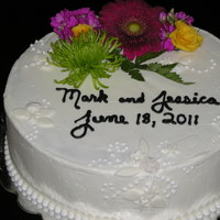 Cutting Cake WASC w/ lemon curd filling, fodant accents, bride requested real flowers.