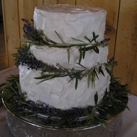 Rogers Wedding Top Tier: TurtleSecond Tier: Banana CaramelThird Tier: Raspberry TruffleStabilized Whipped Cream FrostingReal Lavender and Olive leaves