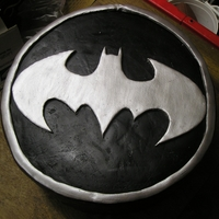 Batman Groom 's Cake Sprinkles cake (groom's request), covered in chocolate ganache, fondant batman symbol.