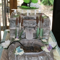 Tammy And Mike's Wedding Cake Garden Pond ThemeWhite cake with buttercream frosting along with gumpaste bricks and fondant pond lilys,butterflies, cattails,flowers. Had...