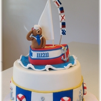 "Teddy Bear Sailboat Dessert display for Christening celebration for my grand-nephew. Cake is 9"" round 6"" tall. Ganache under fondant. Cake sides..."