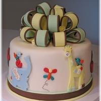 "Baby Safari Cake & Treats Cake and cookies made to match nursery bedding (Play Date). 8"" round banana cake w/white ganache and fondant. Gumpaste bow and fondant..."
