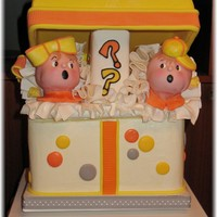 "Boy Or Girl? Ball Caps Or Bows Baby Shower Baby Shower where they do not know if it's a boy or a girl. Colors were orange, yellow, and gray. Gift Box Cake itself is 9""..."