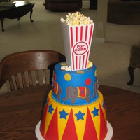 Birthday Circus Done in buttercream with fondant accents. Ran out of time, so the popcorn and popcorn box are both real.