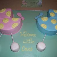 Twins Baby Shower Made to look like invitation. Used stacked cupcakes for wheels and cookies for the rattles.