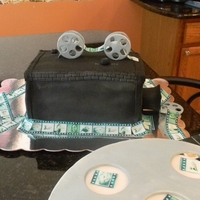 Old Fashioned Video Camera chocolate cake filled with caramel, covered in fondant. fondant accents edible images of my beautiful daughter!