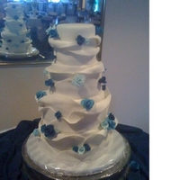 Wraped Cake With Blue Roses This cake was inspired by Mapuce photo