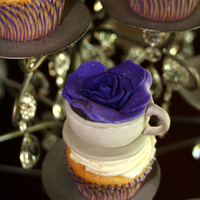 Teacups & Roses Created these cupcakes for a bridal shower teaparty. Cups made from fondant and rose created out of modeling chocolate. TFL!