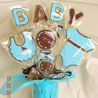 Baby Shower Bouquet Cookie bouquet for baby boy. Shower color were brown and blue.