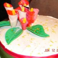 Calla Lily Cake White buttercream icing with multi colored calla lilies. Green & pink ribbon around the bottom. This cake has given me a serious...