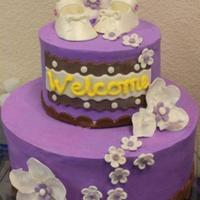 Purple Baby Shower Cake I made this cake for my friends shower. The cake is 10 and 6 inch. Chocolate marble cake with chocolate mouse. Shoes and flowers well all...