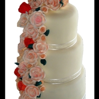 Cascading Roses   6 tier round cake with fondant icing and handmade cascading roses and tulips