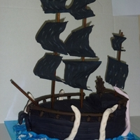 The Black Pearl   Fondant decos including side rales; wooden and crepe paper sails