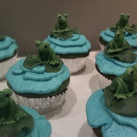 Lily Pad Cupcakes Froggies & Lily Pads modeled out of gumpaste and hand painted. Buttercream icing with vanilla cake dyed blue.