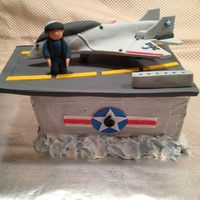 Fighter Jet Cake I made this cake for my son's 6th birthday to look like part of an aircraft carrier, The cake is iced in buttercream. The runway and...