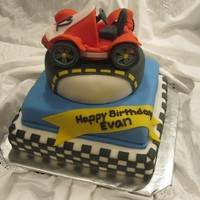 Go-Cart Racing Birthday Cake Vanilla cake covered in fondant. The car is made of fondant, too. Made this for my son's 12th birthday.
