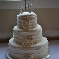 Whimsy White Wedding Cake This is a fondant covered Champagne cake with champagne buttercream.