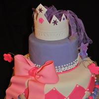 Fancy Nancy Birthday Cake Fancy Nancy Birthday Cake! This is a marble chocolate and white cake with strawberry filling and vanilla buttercream with fondant.