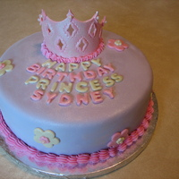 Princess Cake   This is a cake I made for a friends little girls birthday. Fondant accents and shimmer dust.