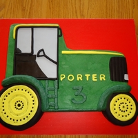 Tractor Birthday Carved from a sheet and frosted in buttercream with fondant wheels and accents.