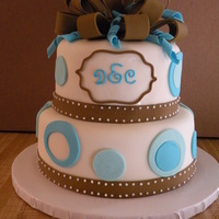 Baby Shower Cake is decorated to match the invitations. The monogram is the baby's initials.
