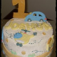 1St Birthday buttercream with fondant decorations.