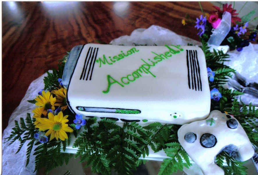 X Box 360 Grooms Cake! carved x box 360 cake, covered with fondant. thank you for looking!