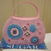 Purse Cakes Someone I know opened a purse shop where the purses help people in impoverished countries and are made from recycled products, for the...